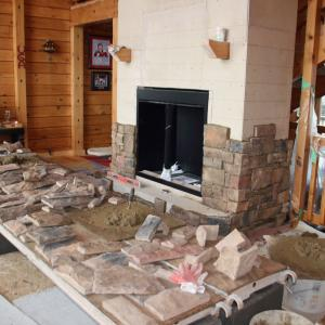 Starting to put stone on fireplace